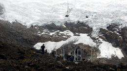 An undated photo released by ANDINA in 2010 shows technicians on the Huaytapallana snowcap