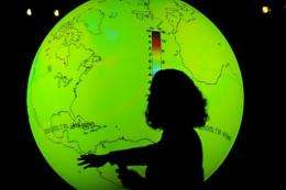 A scientist stands in front of a globe during the United Nations Climate Change Conference in Copenhagen in 2009