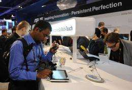 Attendees test new tablet and notebook computers at the 2010 International Consumer Electronics Show