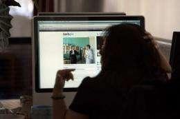 A woman surfs the web
