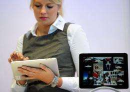 A woman tries out an iPad