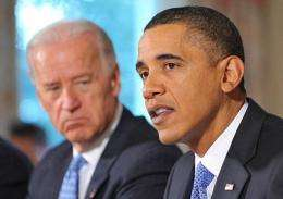 Barack Obama (R) speaks during a meeting to discuss energy policy as Joe Biden (L) looks on