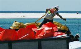 BP sprays more chemicals into main Gulf oil leak (AP)