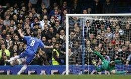 Chelsea's Frank Lampard (left) scores a penalty shot past Aston Villa's goalkeeper Brad Friedel