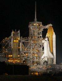 Clouds force space shuttle delay, next try Monday (AP)