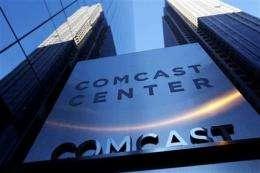 Comcast 2Q profit dips on NBC Universal deal costs (AP)