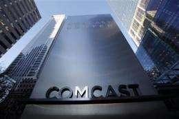 Comcast 4Q profit up on revenue boost, tax gain (AP)