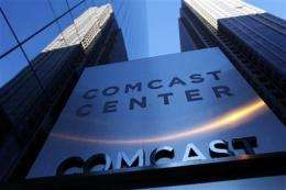 Comcast drives growth with pricier bundles (AP)