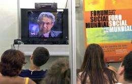 Economist George Soros speaks by teleconference at the World Social Forum in Porto Alegre, Brazil
