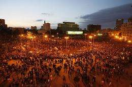 Egyptian demonstrators gather at dusk in Tahrir Square in Cairo