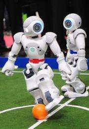 Football-playing robots at the world's biggest high-tech fair, the CeBIT