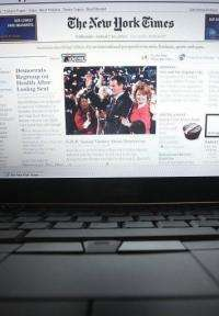 In this photo illustration the NYTimes.com Web site is displayed on a laptop