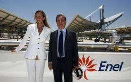 Italian Environment Minister Stefania Prestigiacomo (L) poses with Enel company general director Fulvio Conti