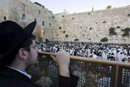 Jewish pilgrims pray at the Wailing Wall