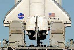 NASA postponed until mid-December the launch of the space shuttle Discovery
