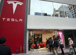 Panasonic invests $30M in electric car maker Tesla (AP)