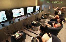 """People play a multi-player video game during an introduction of """"Xbox Live"""""""