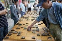 "People play ""shogi"" or Japanese chess"