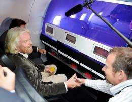 Sir Richard Branson flies on Virgin America's first international flight to Toronto