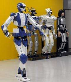 The HRP-4 robot (left) is modeled on a track-and-field athlete