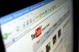 The YouTube webpage is seen on a computer screen