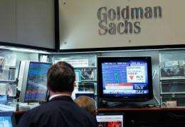 Traders sit in the Goldman Sachs' booth on the floor of the New York Stock Exchange