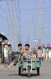 Traffic passes below power lines in Beijing