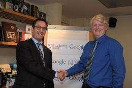 US Google Books head Dan Clancy (R) shakes hand with France's biggest publisher Hachette Livre head Arnaud Nourry