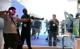 Visitors are seen trying out games at the Electronic Entertainment Expo in Los Angeles