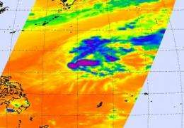 Winds blow off Omais' thunderstorm tops