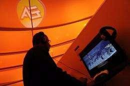 A fair goer plays a game by Electronic Arts (EA) at an entertainment fair