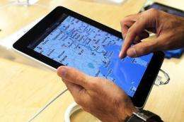 An early customer at the Apple store on Fifth Avenue tries Apple Inc's new iPad