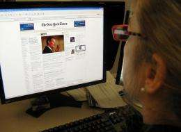 A woman reads the online version of the New York Times