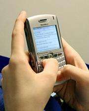 A woman sends text messages