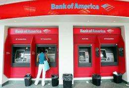 A woman uses an ATM at a Bank of America branch