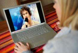A woman watches a YouTube clip of Scottish charity worker Susan Boyle