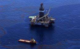 Crews on ships work on stopping the flow of oil at the source site of the Deepwater Horizon disaster