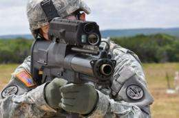 The XM25 uses microchipped ammunition to target and kill the enemy, even when the enemy is hidden behind walls