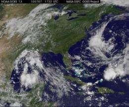 GOES-13 satellite sees elongated system 96L getting organized