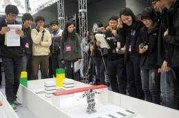 South Korean spectators watching a robot performing