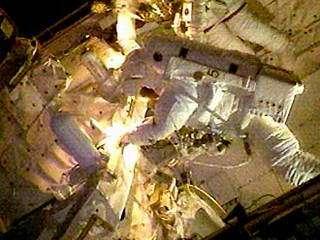 First in-orbit space shuttle repair under way
