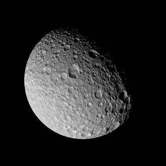 Cassini flies by Saturn's tortured moon Mimas