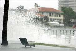 Waves from Hurricane Rita crash over a seawall in Miami, Florida