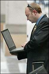 A businessman uses his laptop computer