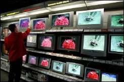 Salesman checks TV sets