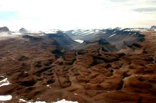 Drainage of Subglacial Lakes Created Canyons of Antarctica 12-14 Million Years Ago