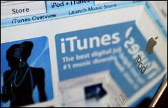 Apple\'s iTunes website is reflected on the polished surface of an iPod