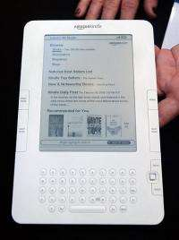 A woman holds the new Amazon Kindle 2 at an unveiling event at the Morgan Library & Museum in New York City