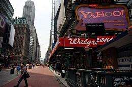 Pedestrians walk by a Yahoo! sign in Times Square in New York City