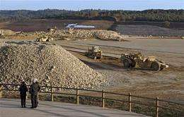 People look at tractors working on the future International Thermonuclear Experimental Reactor (ITER) site in Cadarache